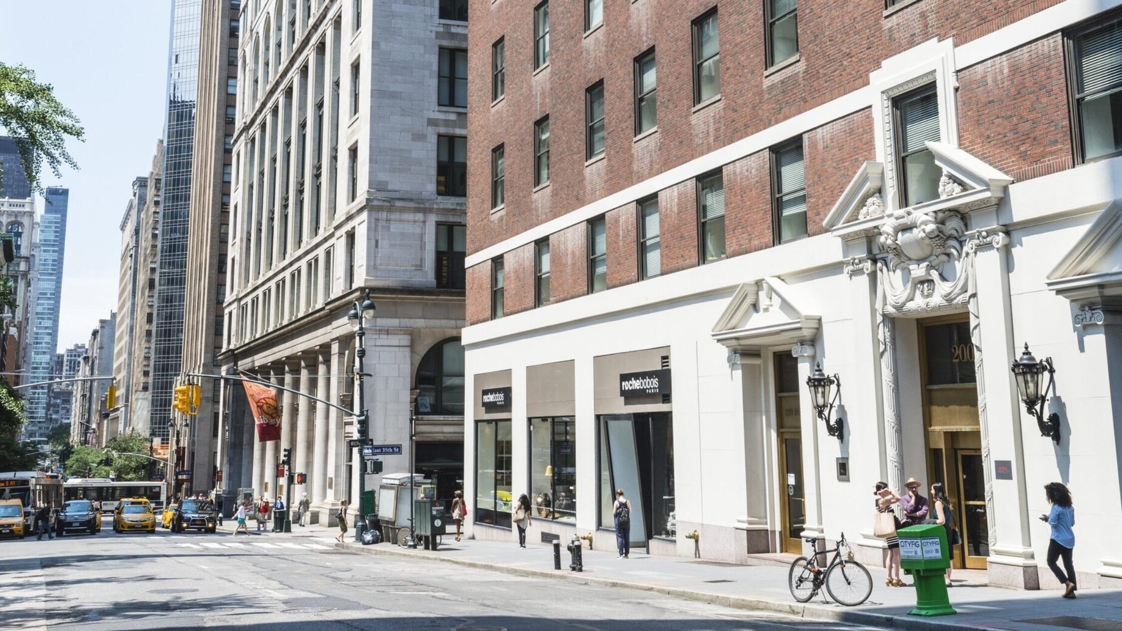 200 Madison exterior with pedestrians on sidewalk
