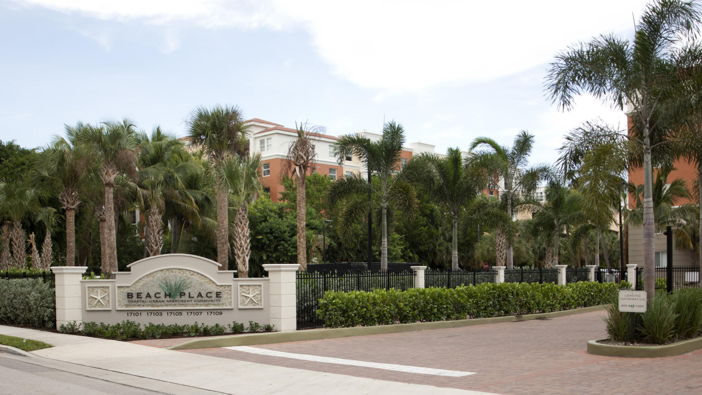 Beach Place main entrance driveway with monument sign and palm trees