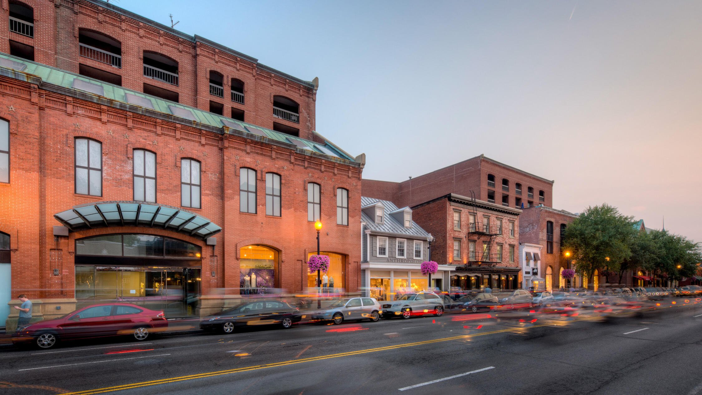 Georgetown Park retail shops exterior at sunset with cars in foreground