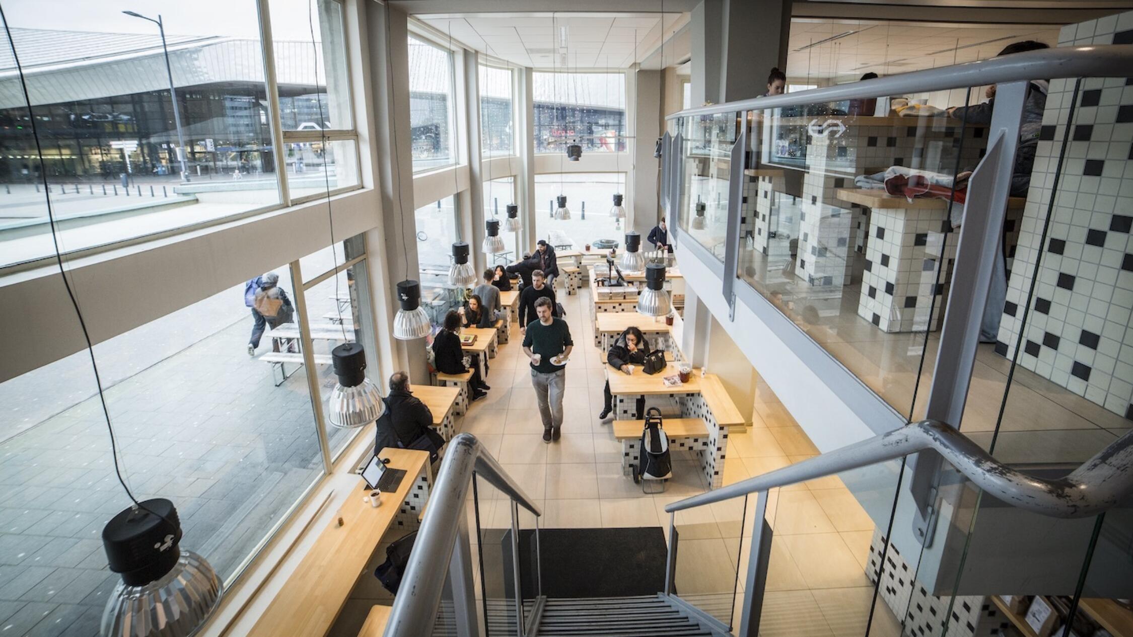 Groot Handelsgebouw interior common area with people working at tables