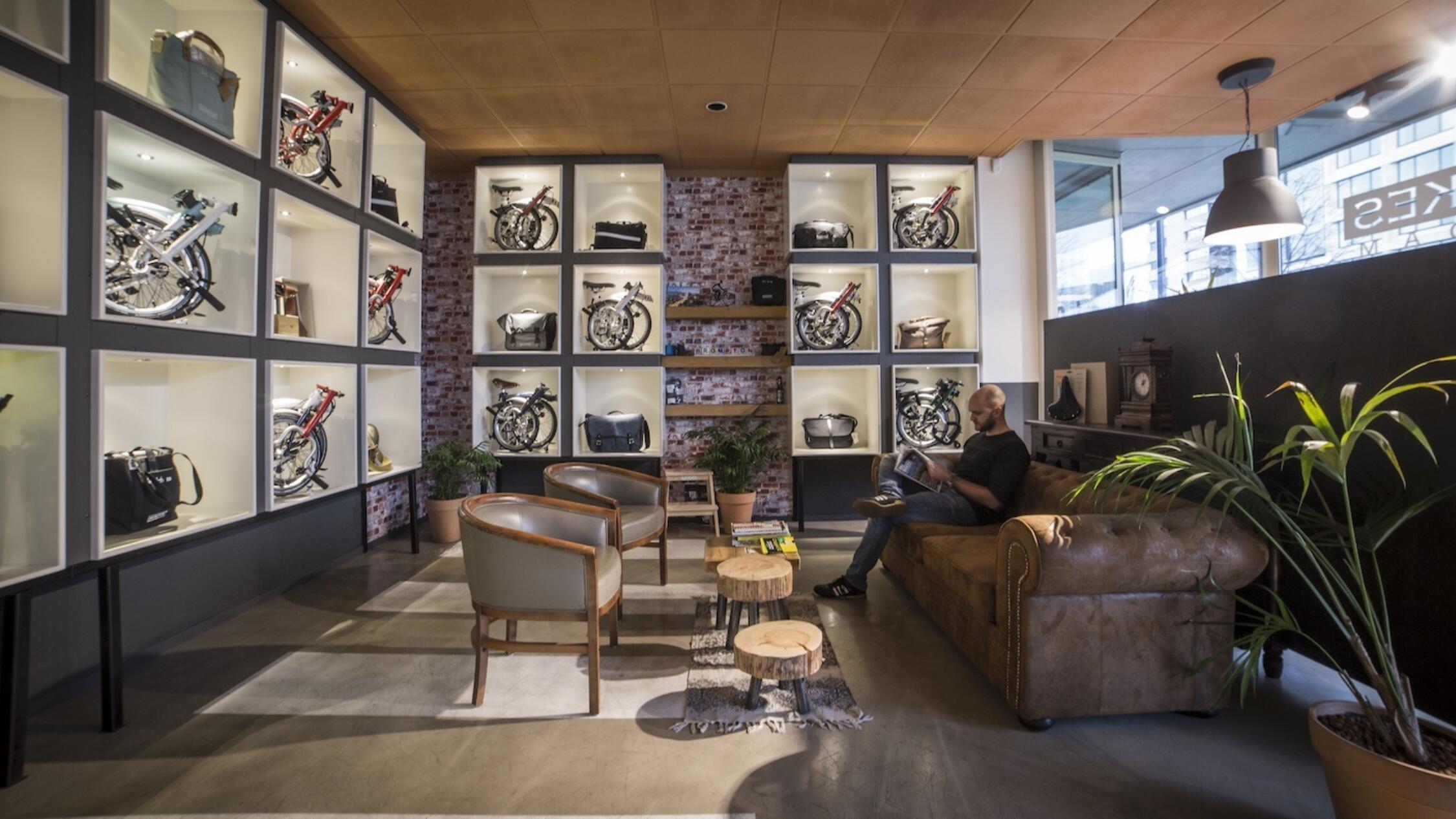 Groot Handelsgebouw interior common area with man sitting on sofa reading