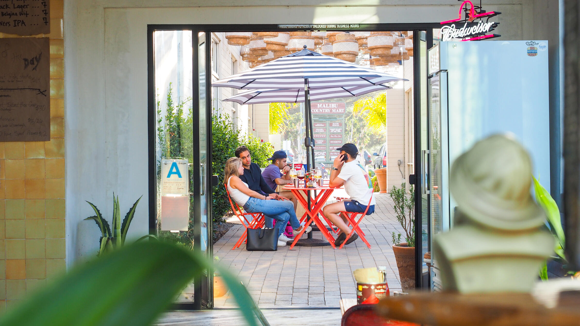 People dining at a patio cafe