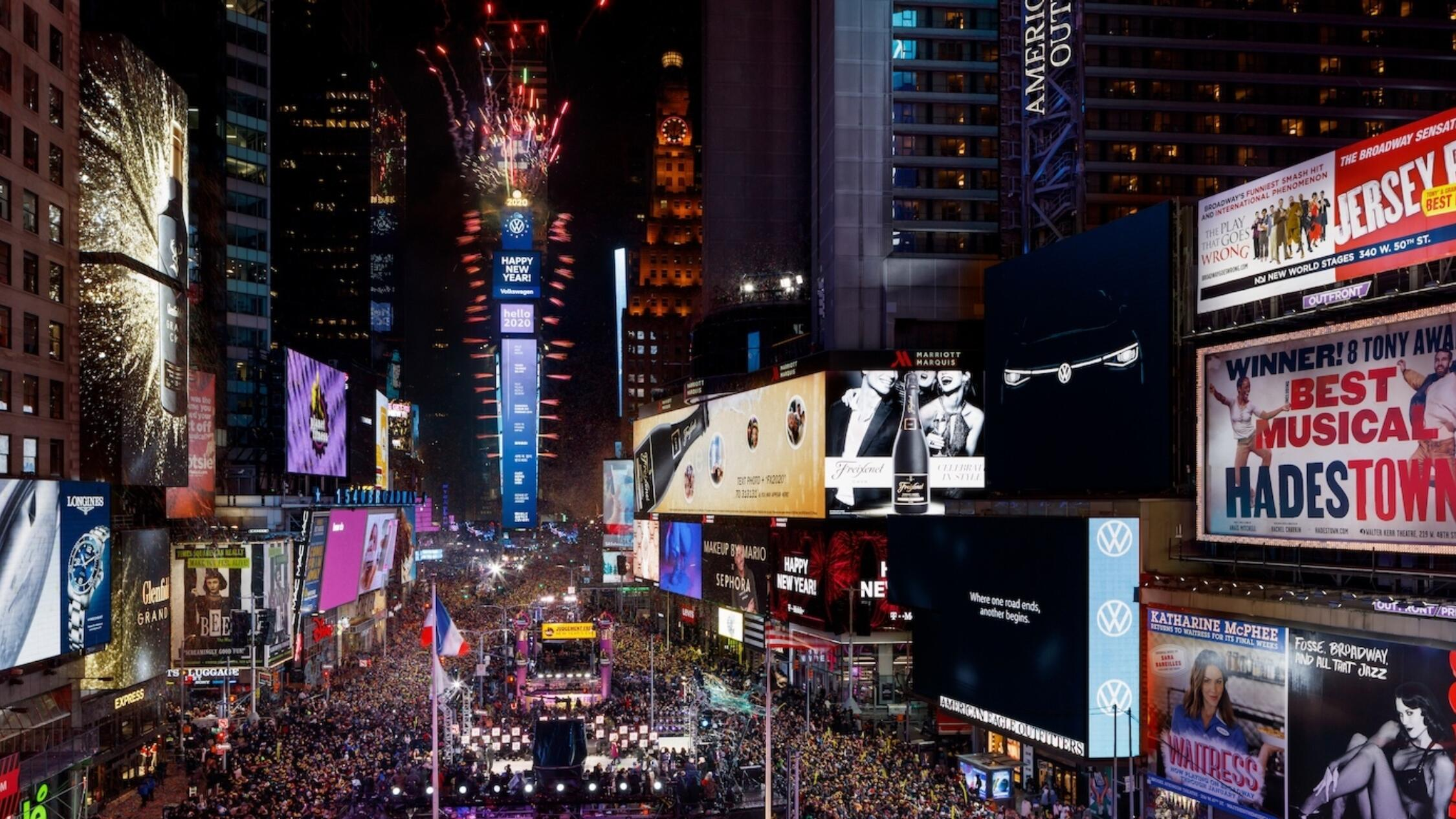 New Year's Eve at One Times Square with massive crowd and fireworks launched from the building