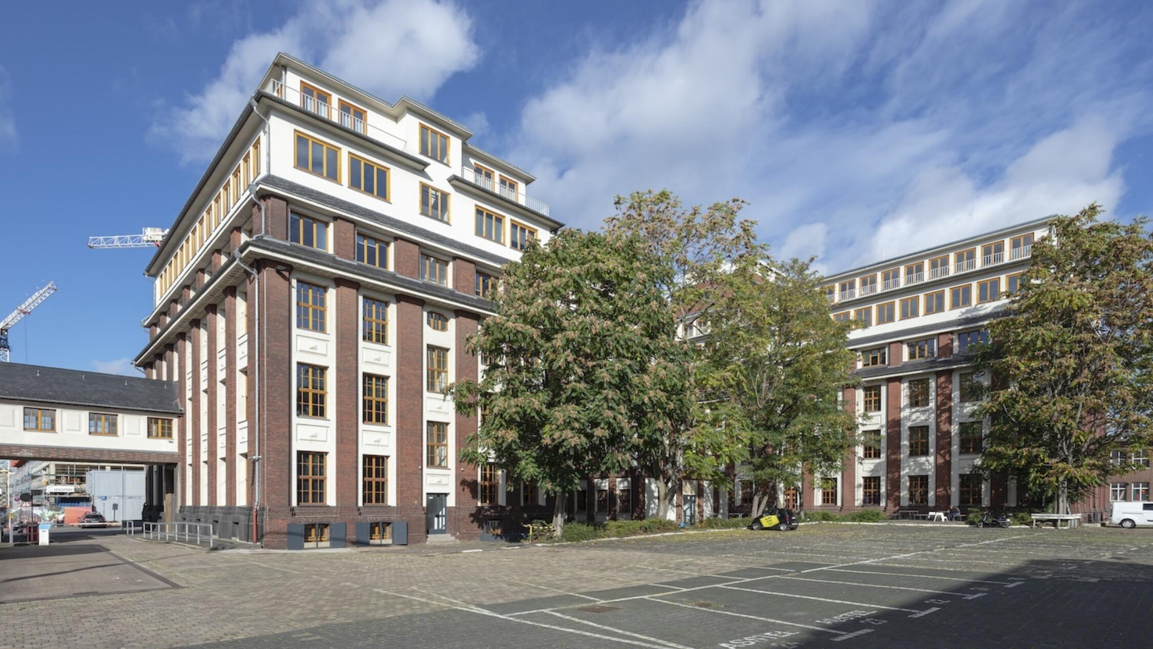 Schanzenstrasse facade with parking lot in foreground lot