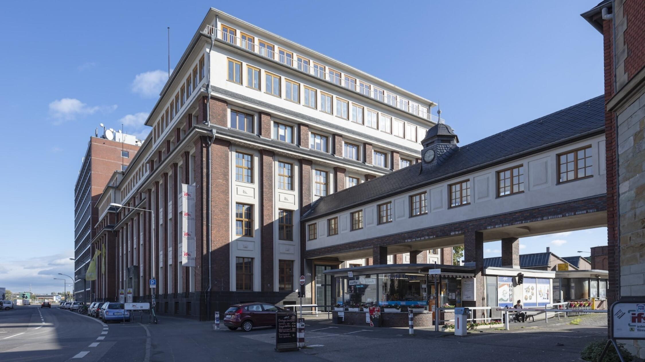 Schanzenstrasse facade with pedestrian footbridge connecting two buildings