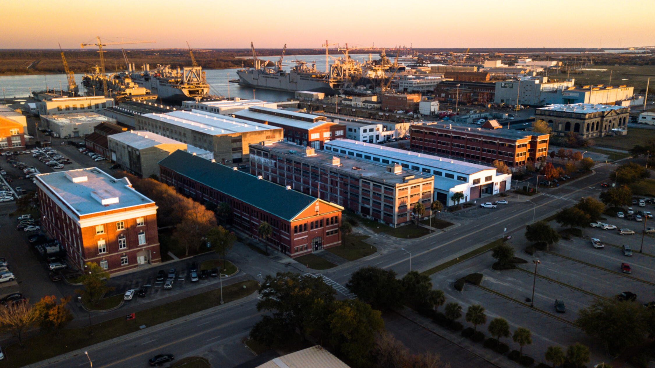 Aerial view of Navy Yard Charleston during dusk with waterway in background