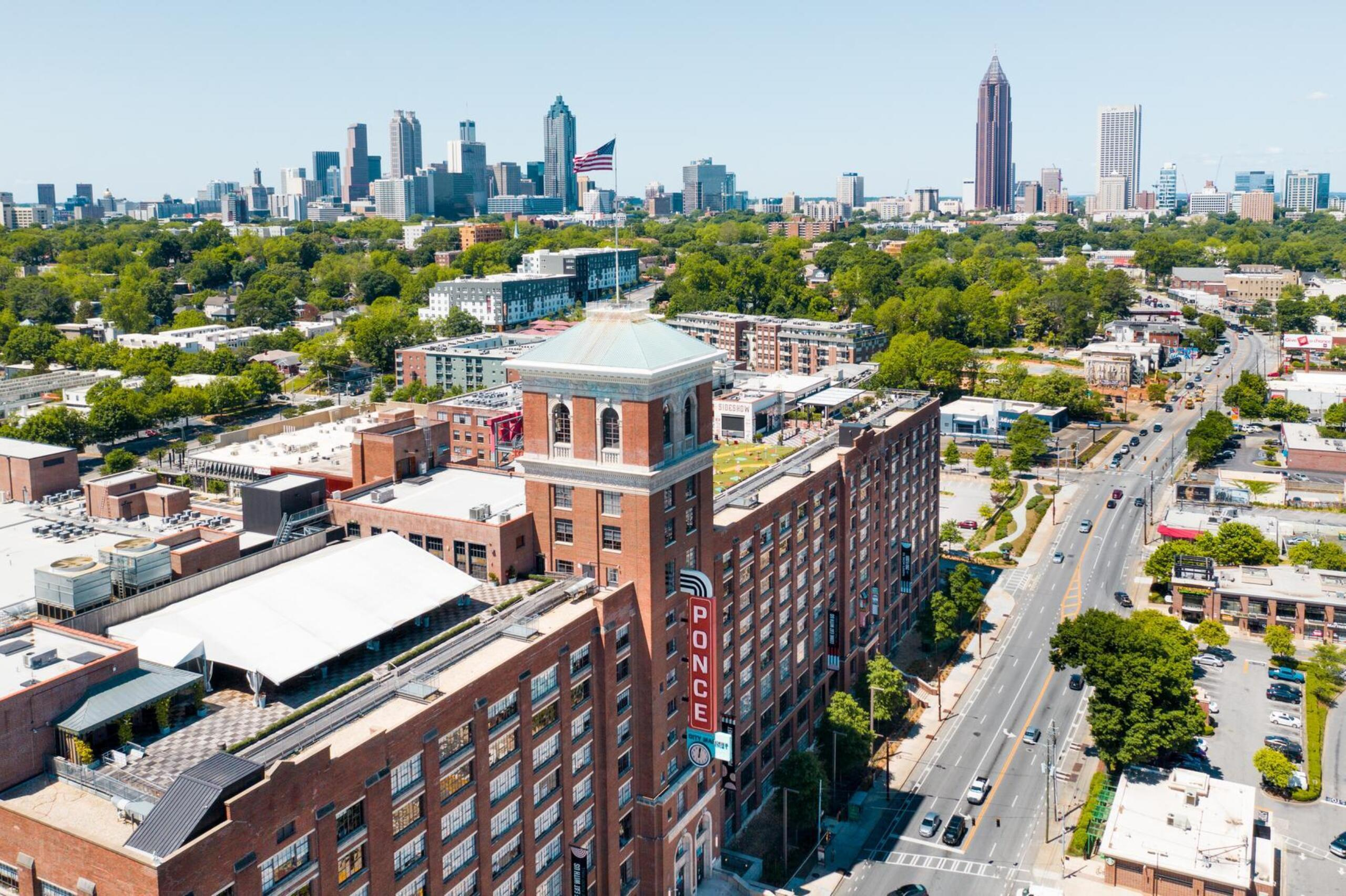 Aerial view of Ponce City Market and Ponce de Leon Avenue with Atlanta skyline in background