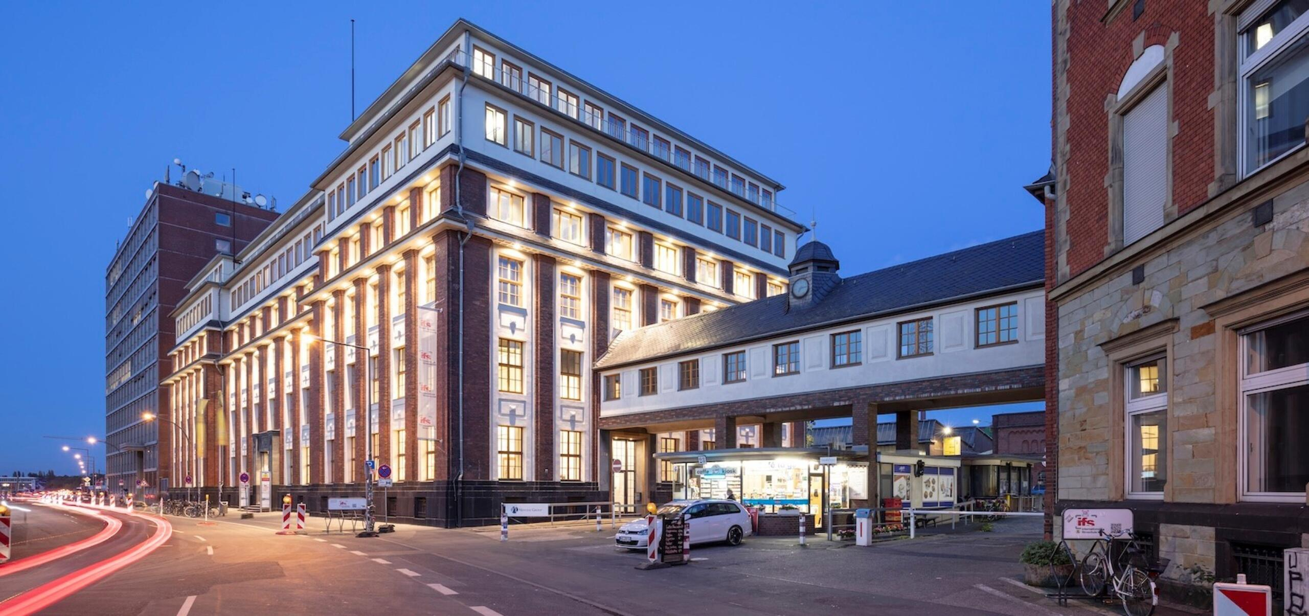 Facades of buildings at Schanzenstrasse 22, 24, and 28 during evening