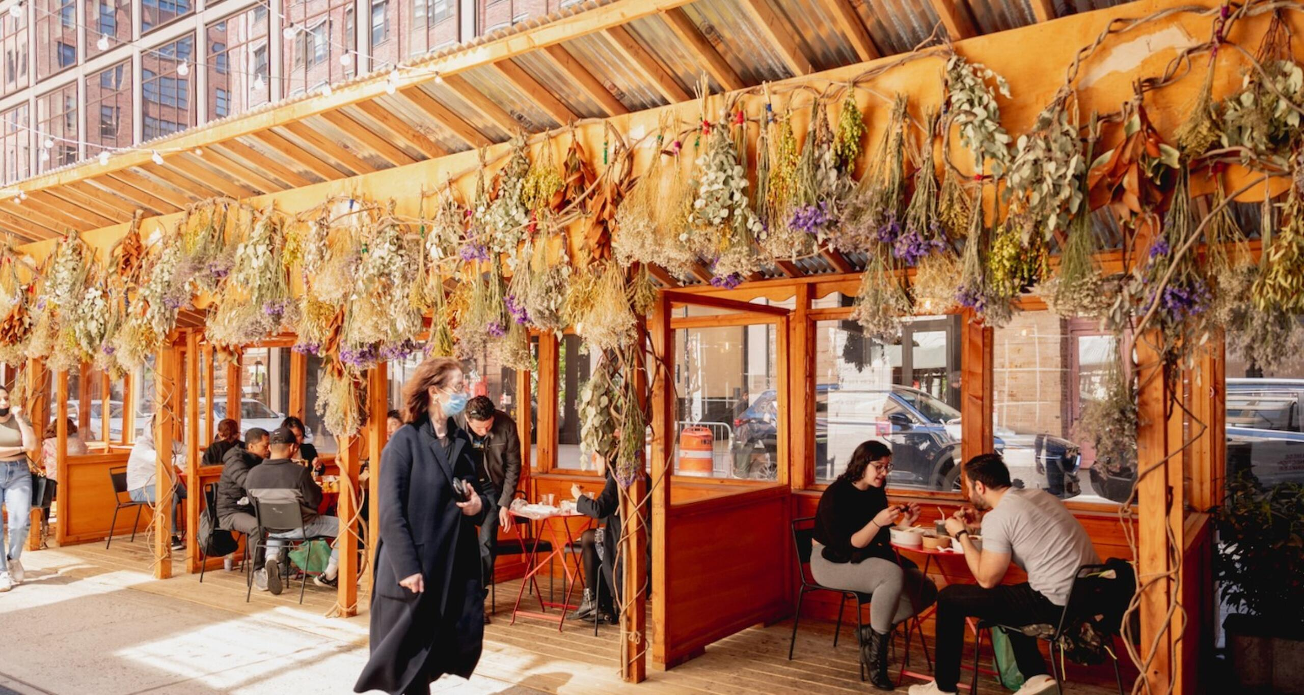 Diners seated at outdoor dining area at Chelsea Market