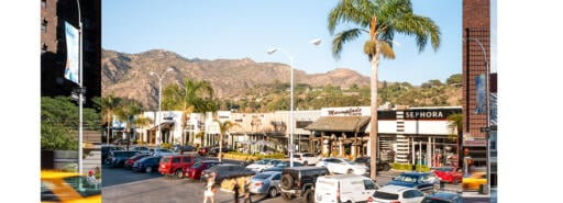 Shoppers walk through the parking lot at Malibu Village