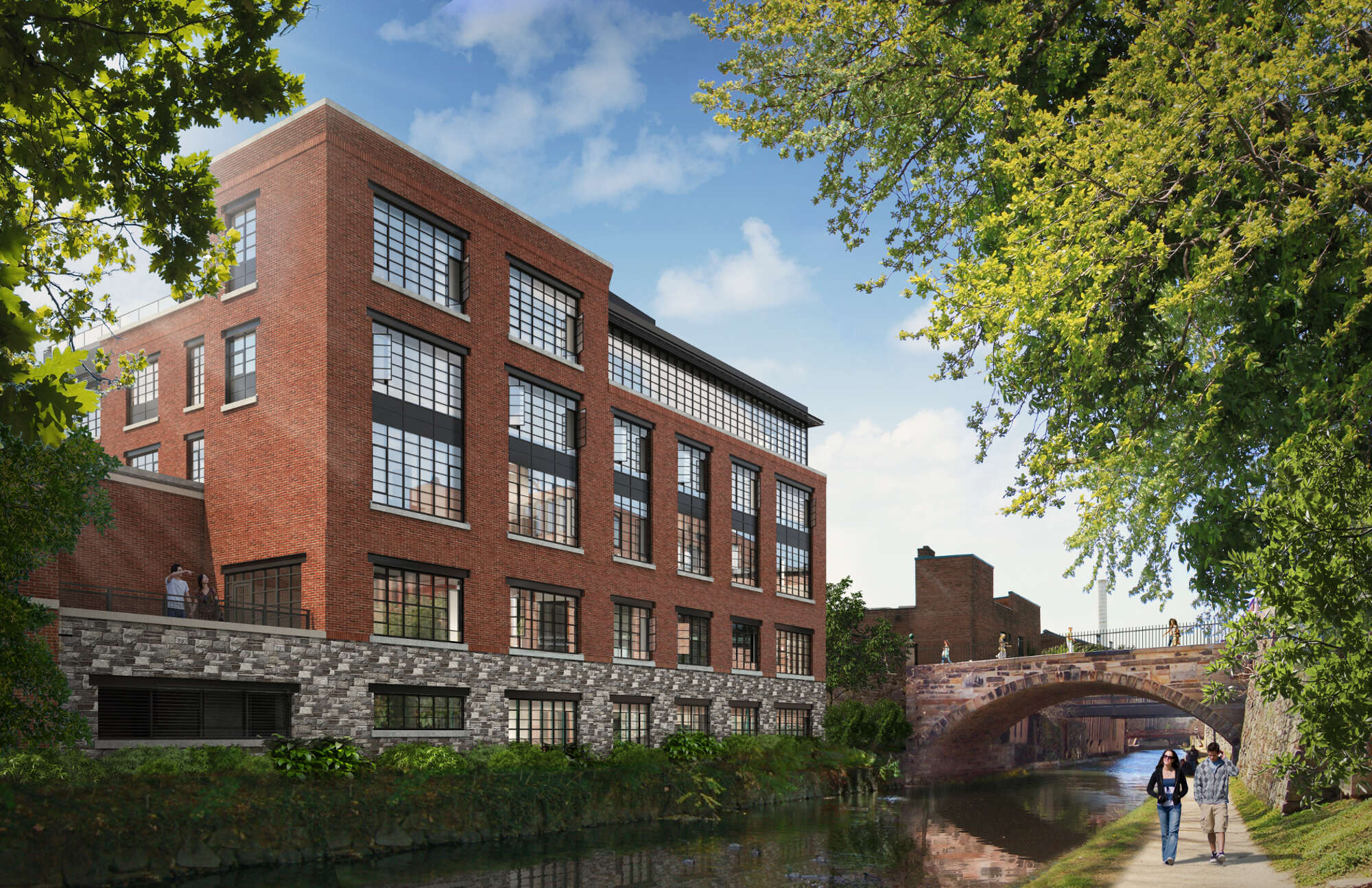 A rendering of a brick building on the river with people walking on the other side.