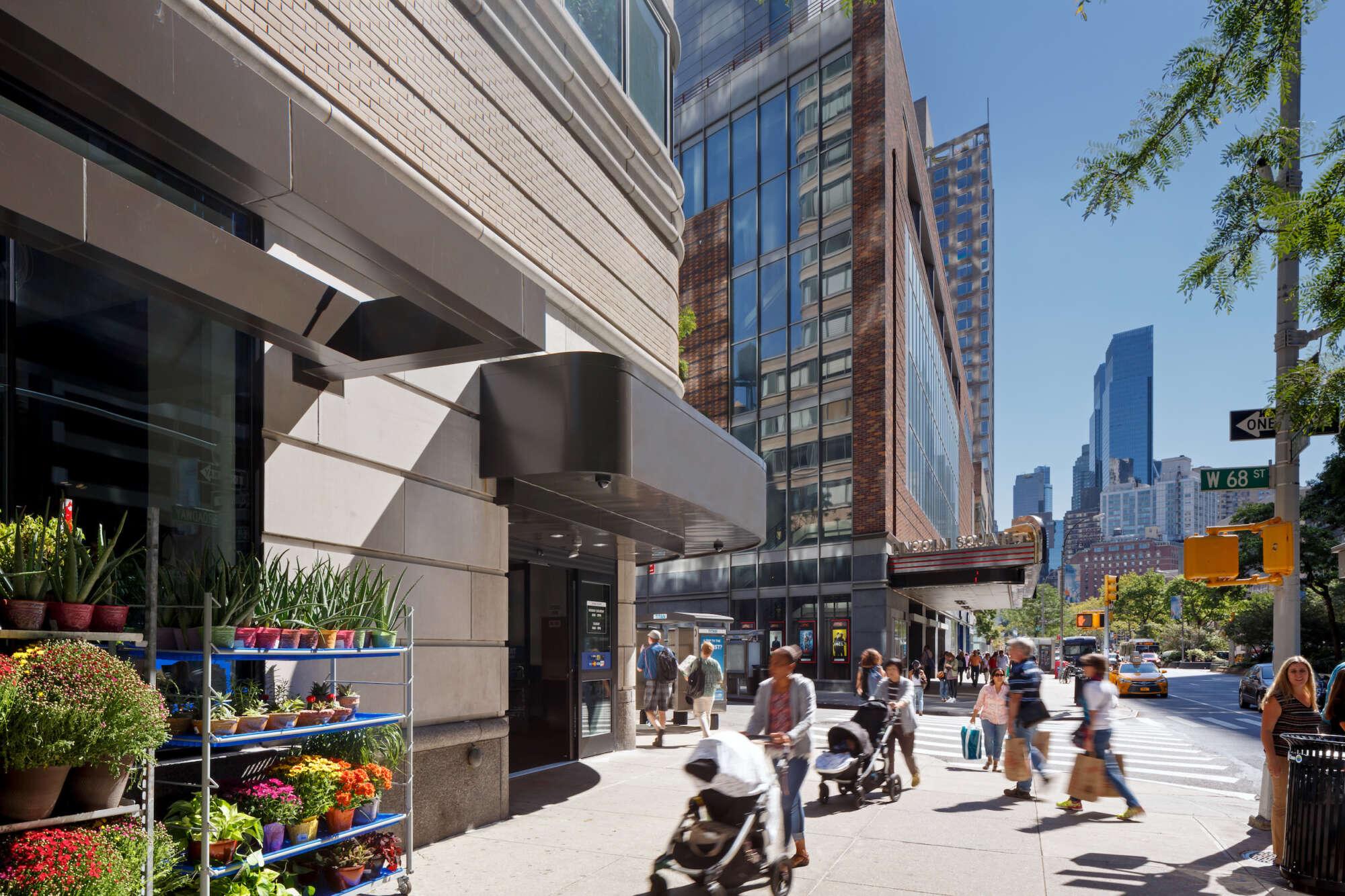 2000 Broadway retail store facade with pedestrians on sidewalk