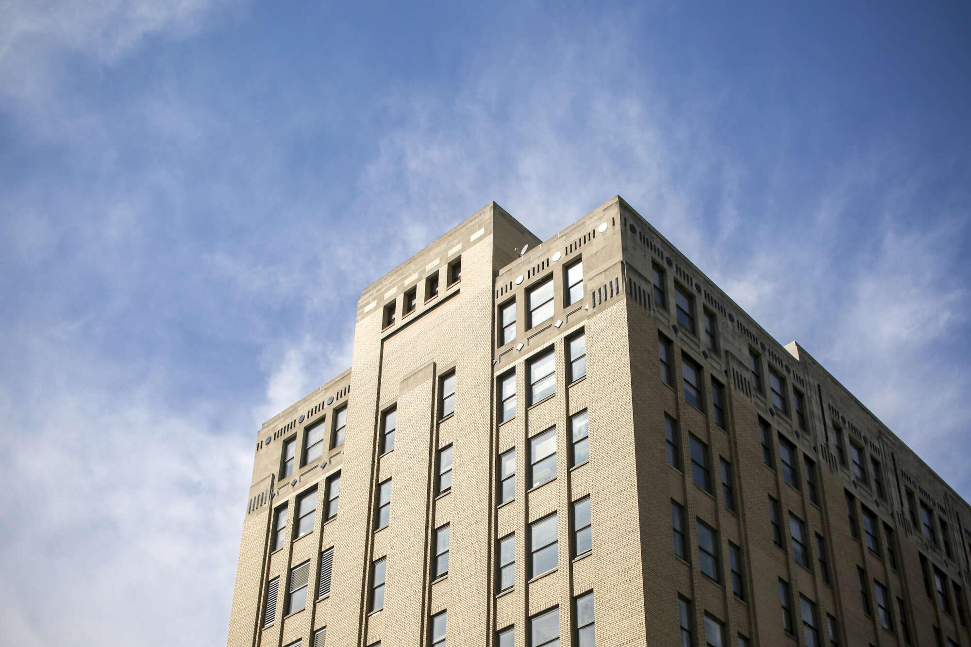 260 East 161st Street building upper floors framed against cloudy blue sky