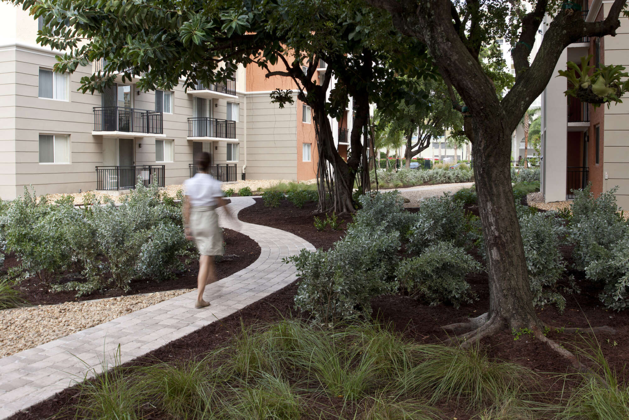 Beach Place exterior common area path with pedestrian