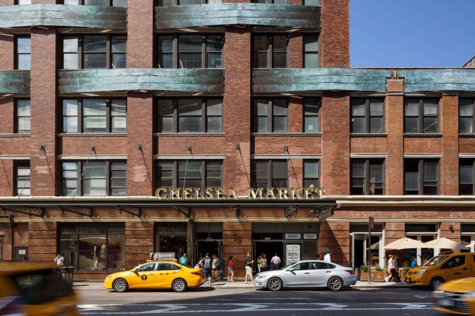 Facade of Chelsea Market with New York City yellow cabs out front