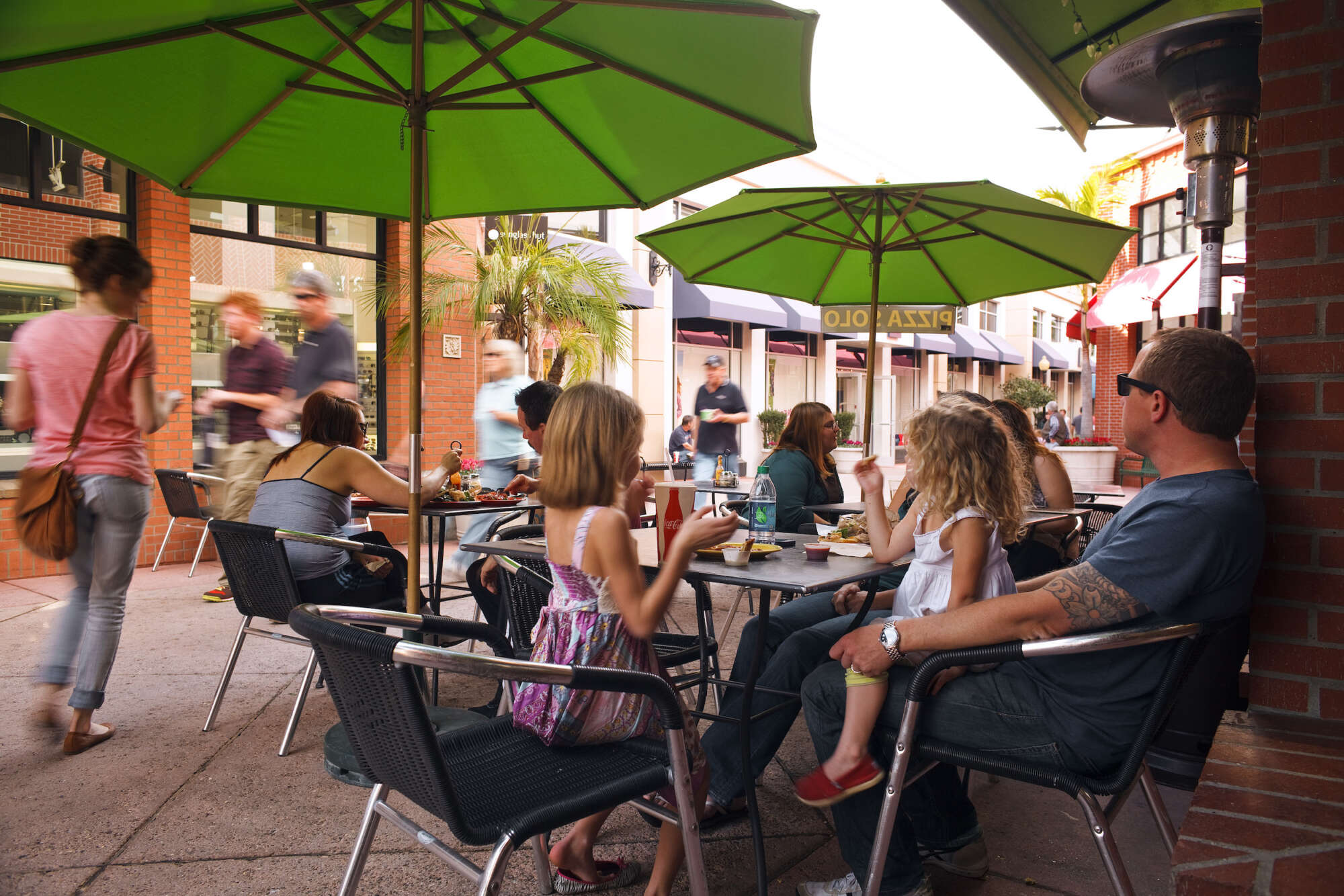People sitting at outdoor cafe at The San Luis Obispo Collection