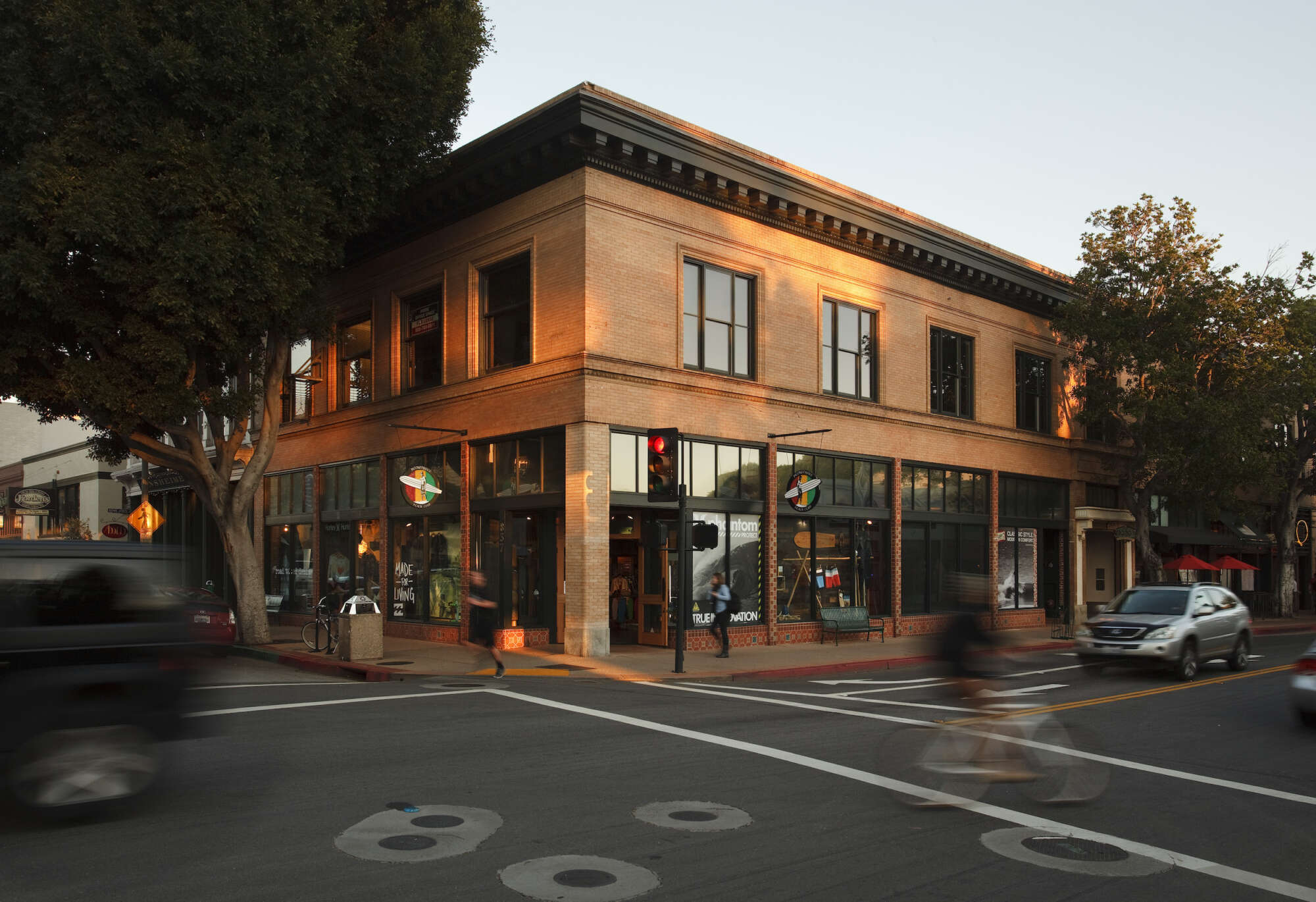 Street corner at The San Luis Obispo Collection with cyclist passing by