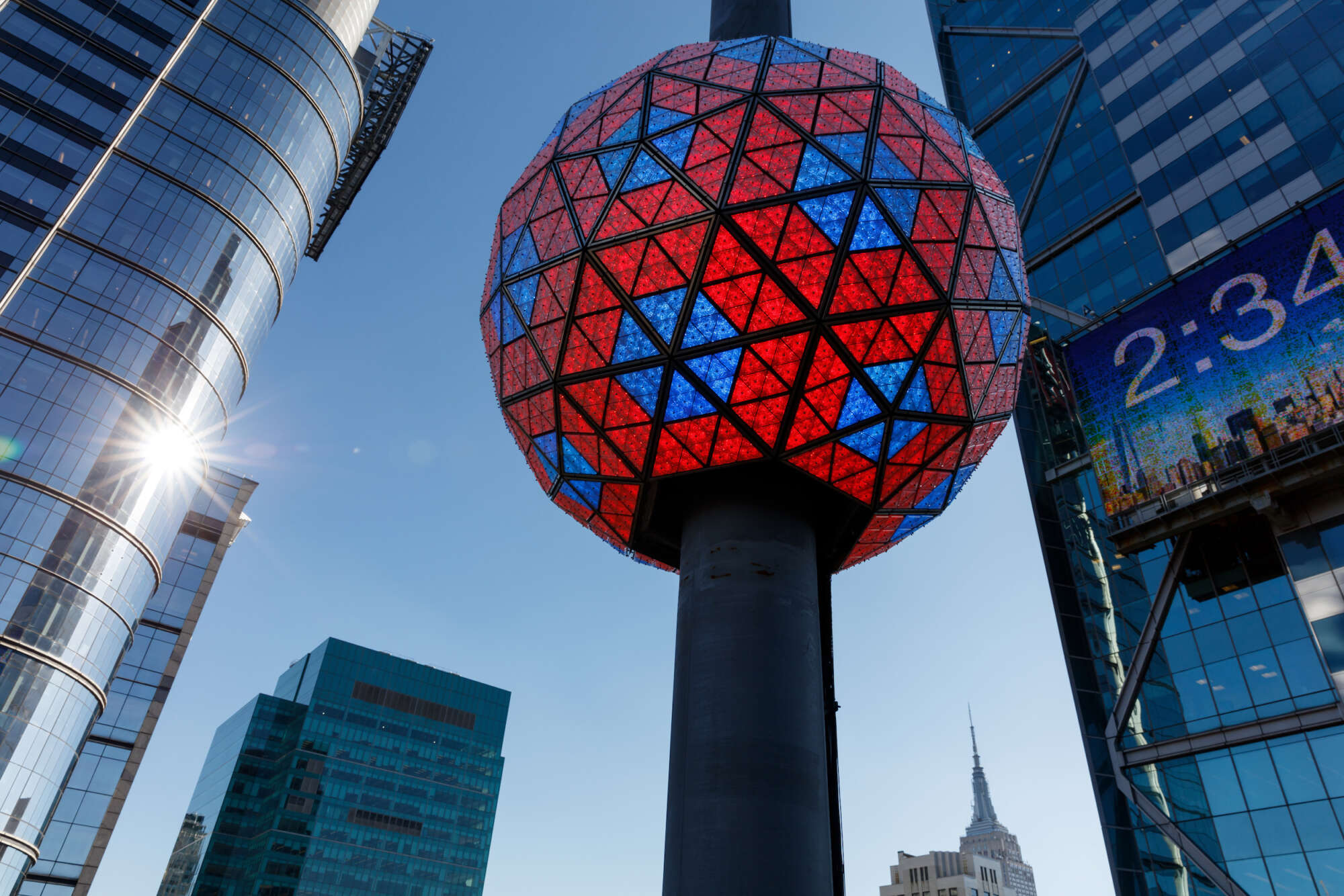 The large crystal New Year's Eve Ball on the top of One Times Square is lit red and blue.