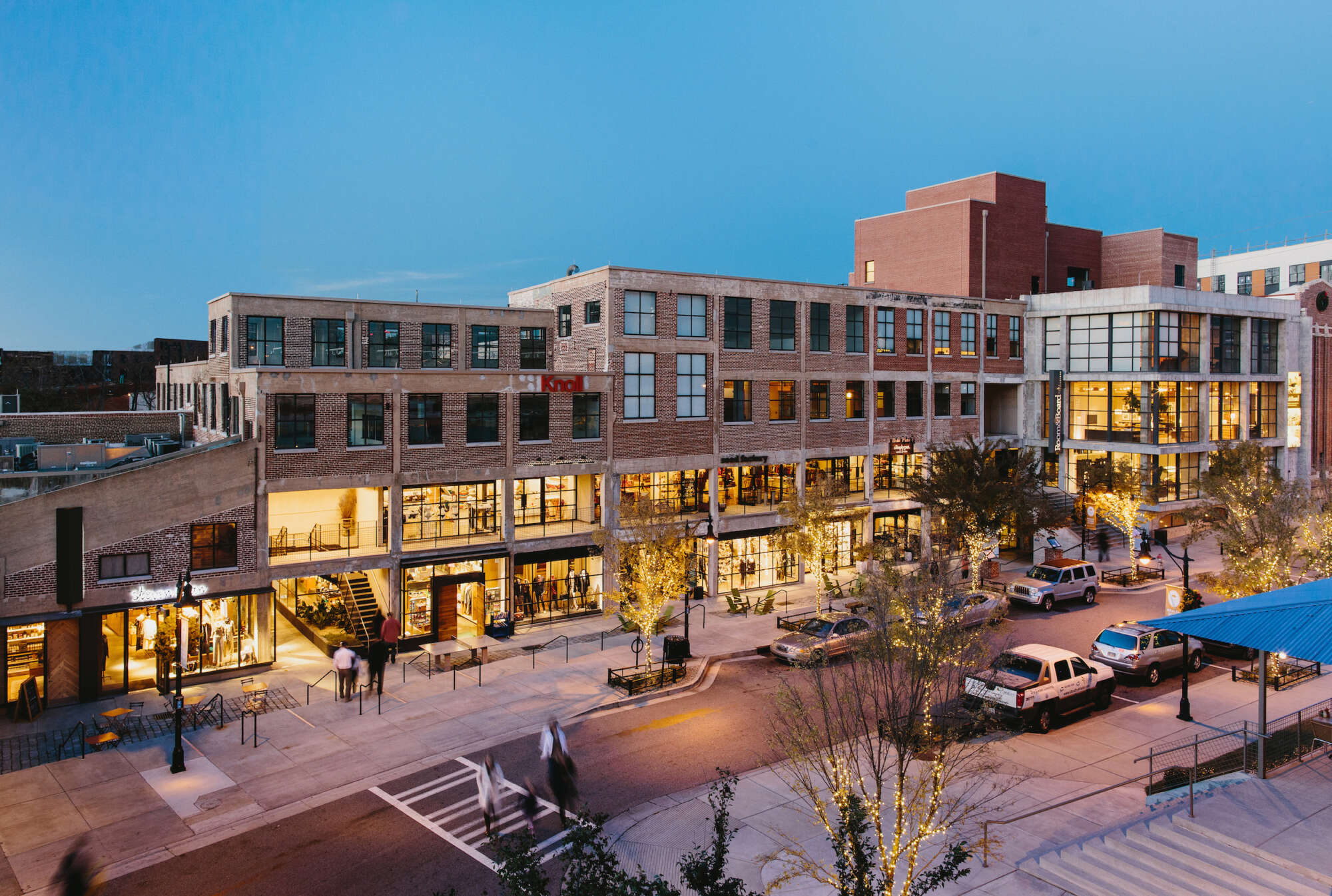 Elevated view of Westside Provisions District at evening with people crossing the street