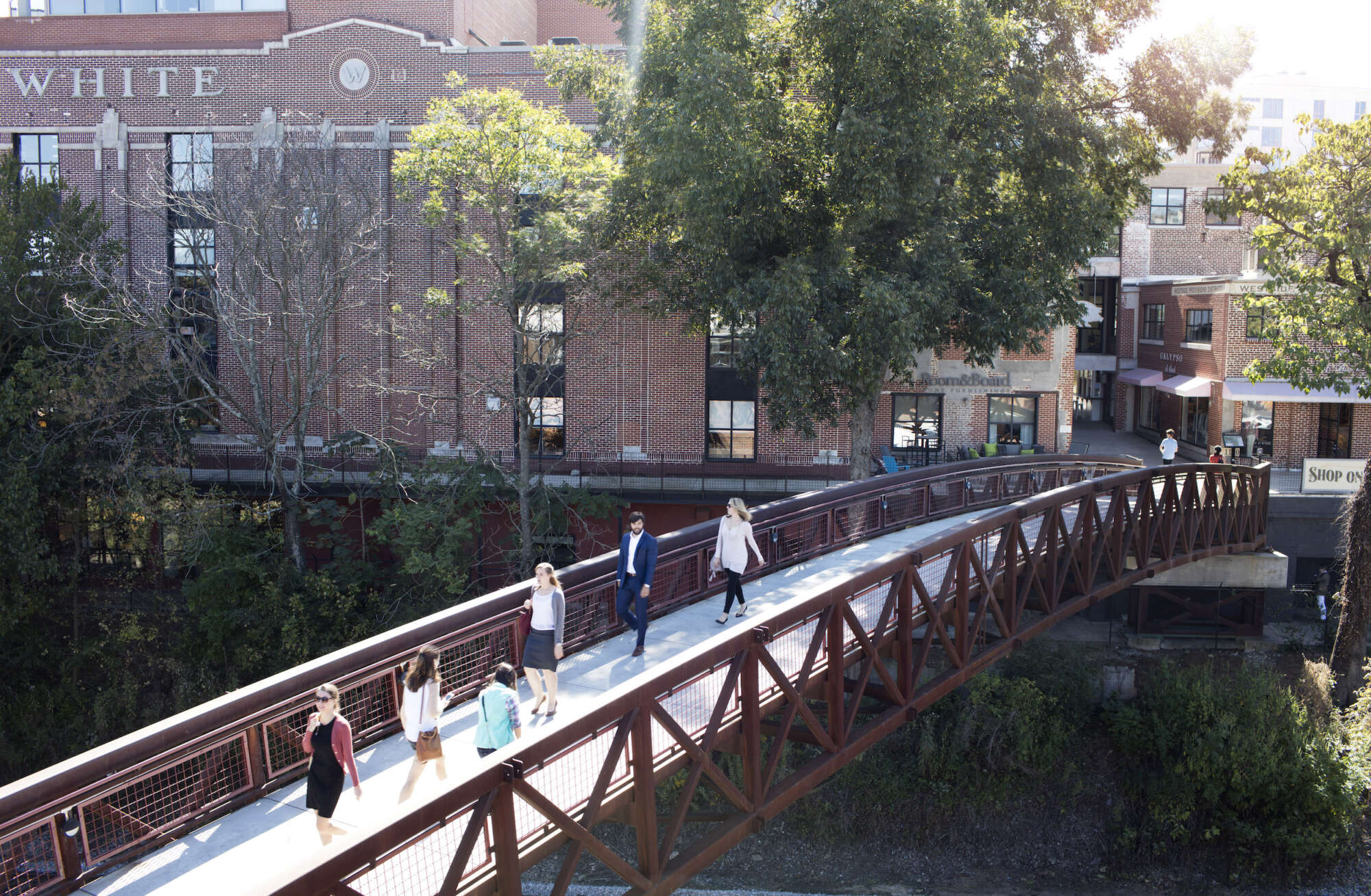 View of the bridge at Westside Provisions District in the daylight with people crossing over