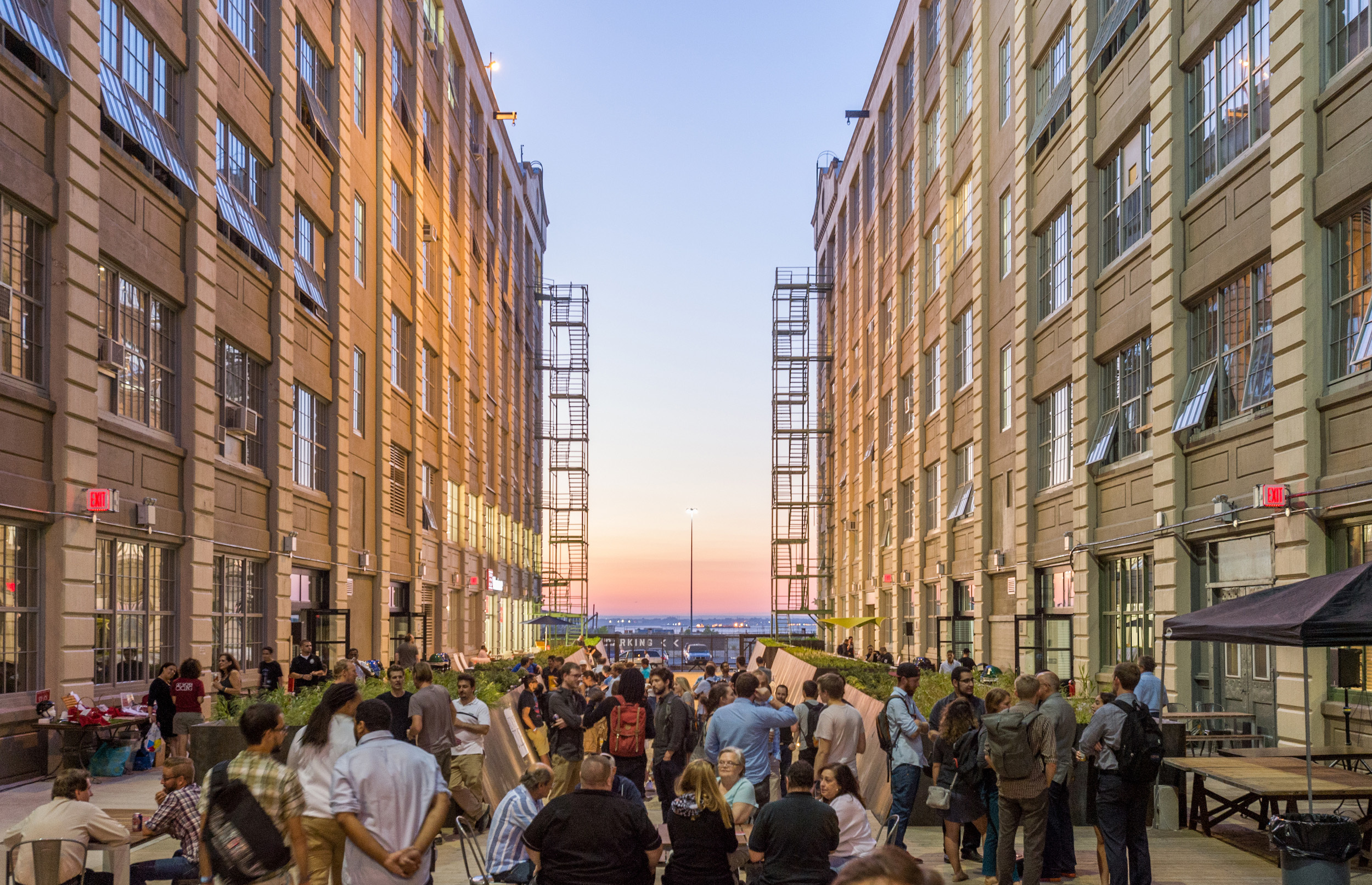 Industry City courtyard at dusk with attendees at an event