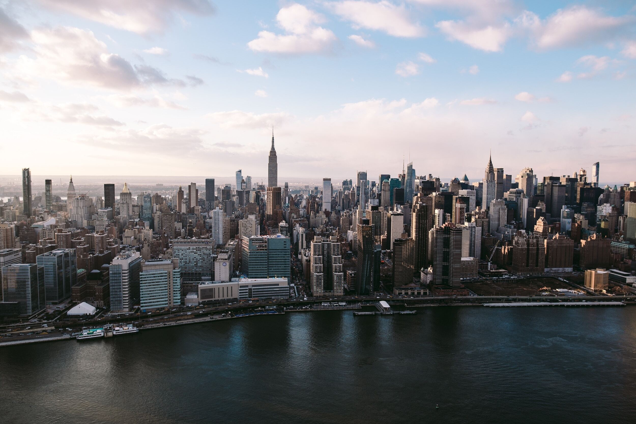 Aerial view of Manhattan skyline with river in foreground