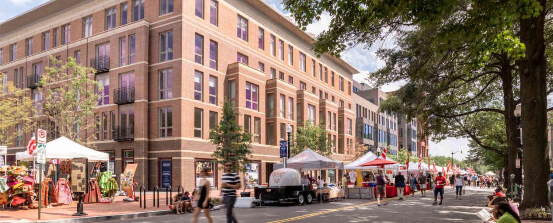 700 Penn building facade with street fair tents and pedestrians