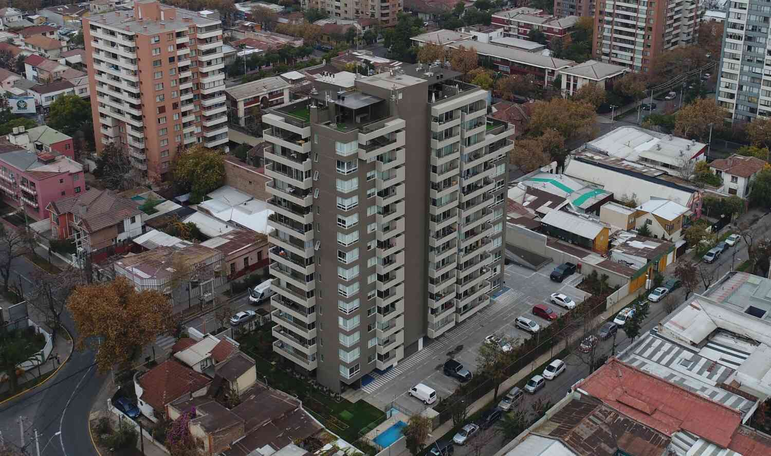 Brown and white apartment building from above